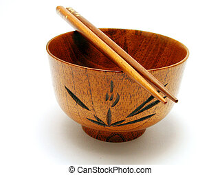 Bowl And Chopsticks - wooden bowl and chopsticks over white...