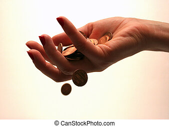 Money through finger - Coins slipping through a woman's...