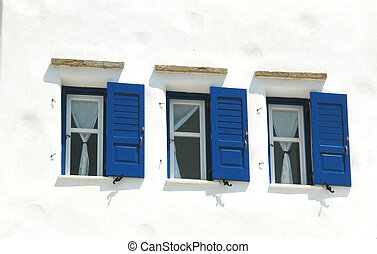 GREEK ISLANDS - windows on a guest house in typical cycladic...