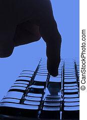 Return in Blue - Finger touching the return key