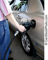 Pumping Gas (3) - Shows the proper way to hold the nozzle...