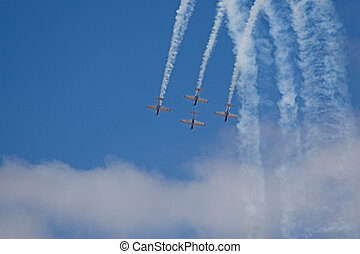 four planes in formation with vapour trails - four planes...