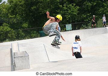 Skateboarder Flipping Board