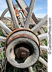 old rusting wagon wheel - an old wooden wagon wheel in...