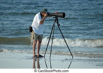 Bird Watching - Man photographing water birds, Ft Myers...