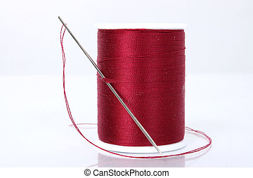 Needle And Thread - Large needle and thread. Focus where...