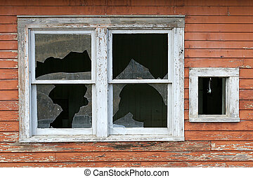 old broken window - an old, broken window on a wooden home...
