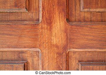 Woodwork - Closeup of a massive wooden door.