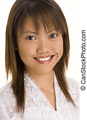 Girl In White 2 - A pretty young asian girl in a white lacy...