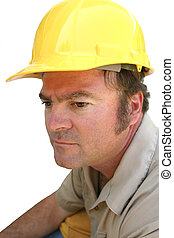 Serious Hard Hat Guy - A man in a hard hat, looking serious.