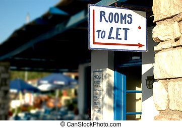 rooms to let sign in the greek islands with the background...