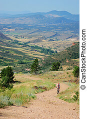 Uphill grind - Cross country mountain biker
