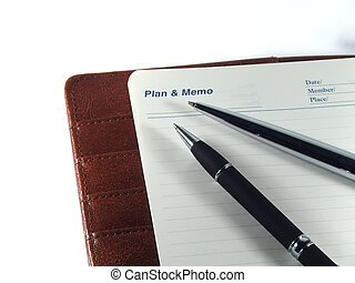 Pens on memo agenda - Pens and agenda for business men
