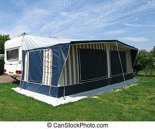 Caravan with tent