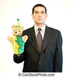 Serious Businessman with Puppet - Serious-looking...