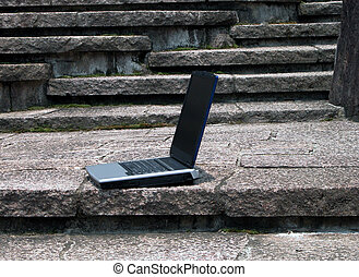 Computer anywhere - Laptop on the rocks stairs