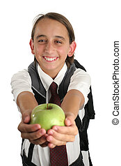 Teachers Pet - A cute young boy holding out an apple for the...