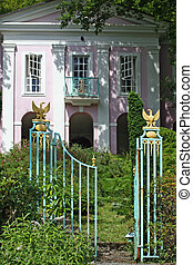 A pink house - Elaborate gates invite you into the pink...