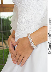 Embroidered bodice - Brides hands on wedding dress