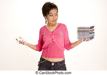 All These - A young asian woman balances a stack of CDs and...