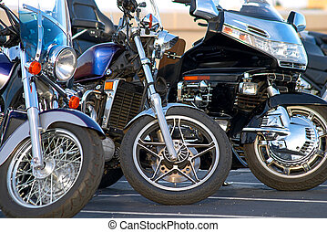 Three Motorcycles - Three motorcycle lined up in a row.