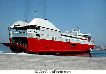 ferry boat - a high speed ferry boat at the port with smoke...