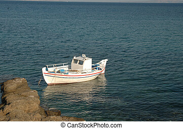 fishing boat - a greek fishing boat with reflection
