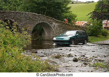 Village ford - Traditional English village ford with bridge,...