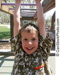 child playing on monkey bars