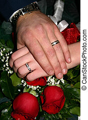 Wedding hands - Man and woman's hands with wedding rings...