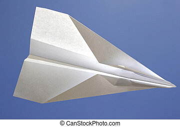 In Flight - Paper plane flying with blue sky behind