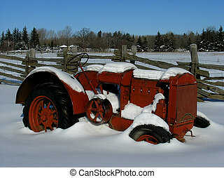 Agriculture machiner - An old model tractor during the cold...