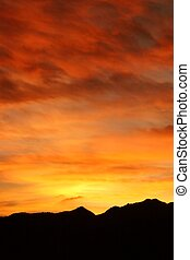 Blazing Sunset - The brilliant yellow and orange colors in a...