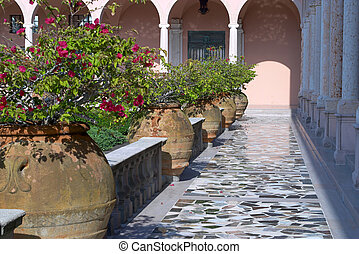 Pots of Bouganvillea - An elegant courtyard of a...
