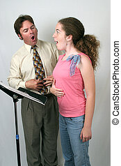 Voice Class Diaphram - A voice teacher showing a student how...
