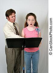 Voice Lesson Front 2 - A voice teacher instructing a...