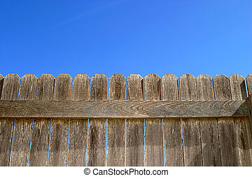 Wood Fence Wide - A wooden fence against a bright blue sky A...