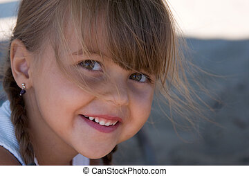 happy little girl - a cute little girl smiling