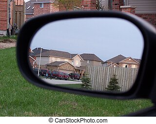 Rearview Mirror - suburban street reflected in rearview...