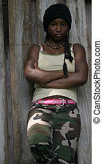 Hip Hop Girl - A teenage girl leaning against a fence.
