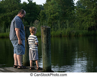 Smirk - A father and son having a talk at the end of a pier.