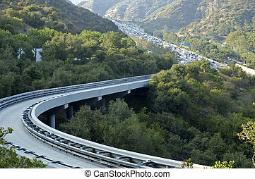 Curve on the tram tracks going up a hill 405 freeway on the...