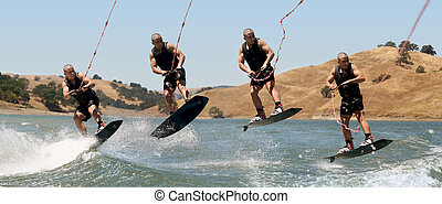 Boy Wakeboarding - Multiple shots of a teenage boy jumping...
