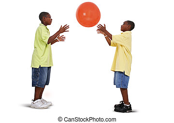 Brothers Playing With Giant Orange Ball - Two brother...