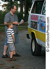 Classic Childhood - A father and son buy a treat from the...