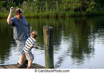 Throwing Stones - A father and son throwing rocks into the...