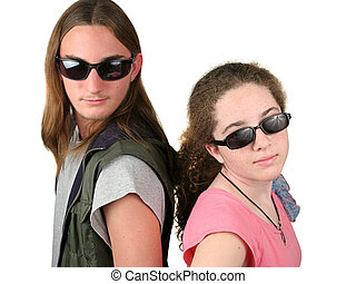 Mulder & Scully Jr 2 - two teens with sunglasses on looking...