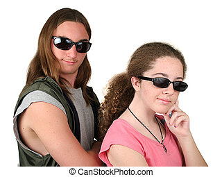 Mulder & Scully Jr - two teens wearing sunglasses and...