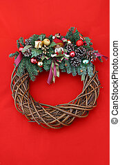 Christmas Wreath Red - A Christmas wreath on a red...