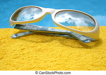 Sunglasses - Futuristic sunglasses on yellow towel by pool